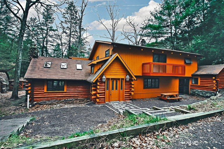 modern log cabin retreat with a pool and hot tub near bushkill pennsylvania Bushkill Falls Cabins