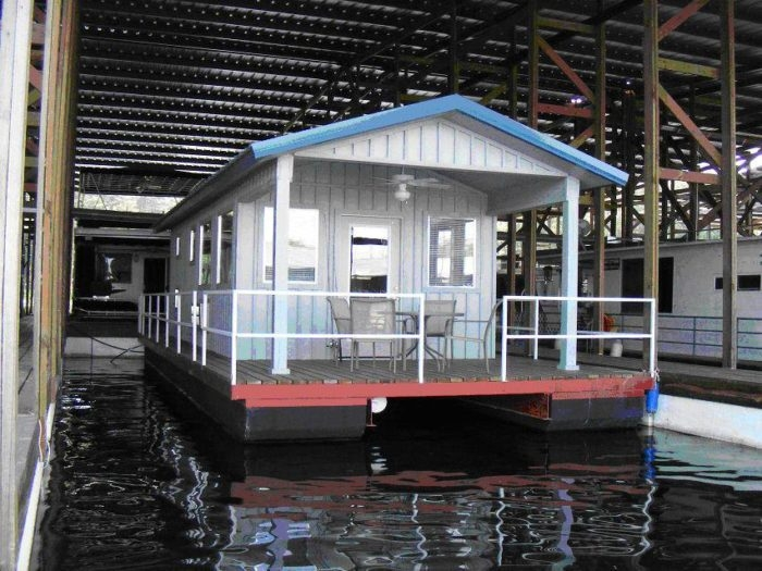 wondering what to do in kir stay in a floating home Lake Greeson Cabins