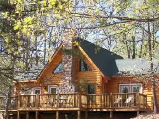 a cute wooden log cabin with a stackstone chimney what i Branson Log Cabins