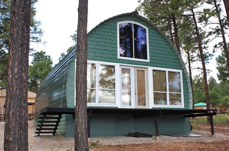 these prefab arched cabins provide cozy homes for under 10k Small Prefab Cabins