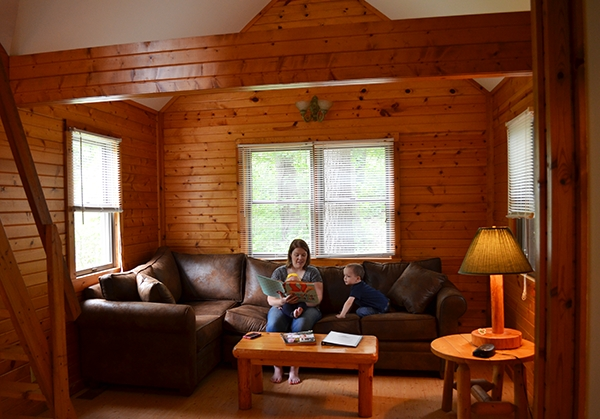 family room of a legendary cabin at lake rudolph campground Holiday World Cabins