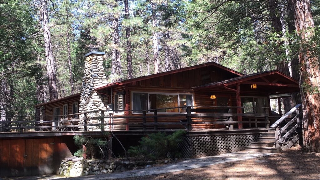 log cabin nestled in the pine trees in yosemite national park wawona Yosemite National Park Cabins