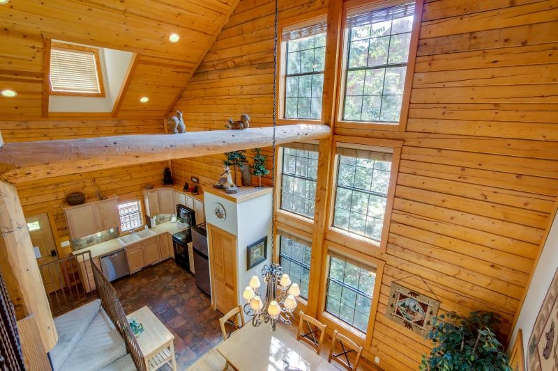 rustic cabin in the heart of branson has porch and central Branson Log Cabin Rentals