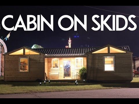 small mobile cabin on skids with built in porch Log Cabin On Skids