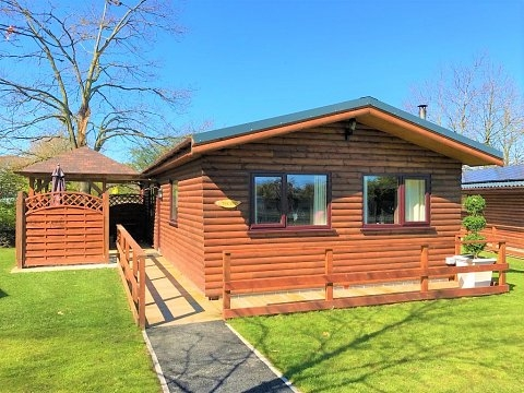 log cabins with hot tubs in north wales llannerch holiday Berth Log Cabins With Hot Tubs