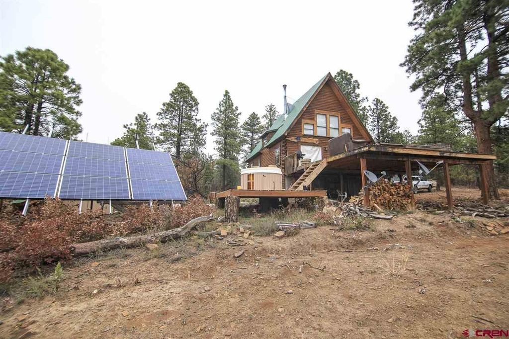 off the grid Solar Panel Retreat Cabin