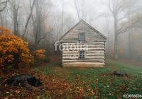 cabin in fog and autumn color at peaks of otter on the blue Peaks Of Otter Cabins