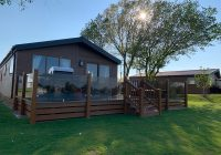 hideaway 2 8 berth 2 shower room lakeside luxury hot tub Berth Log Cabins With Hot Tubs
