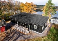 super insulated modern log cabin withstands frigid finnish Finnish Log Homes