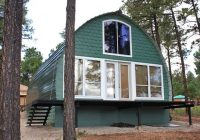 these prefab arched cabins provide cozy homes for under 10k Prefab Cabin Kits