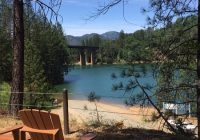 view of lake shasta behind our 1 bedroom cabins at salt Lake Shasta Cabins